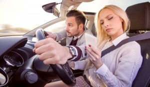 Woman typing text message while driving a car