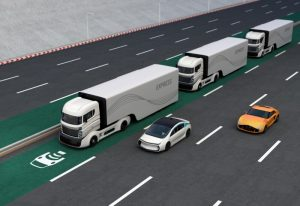 Fleet of autonomous hybrid trucks driving on wireless charging lane. 3D rendering image.